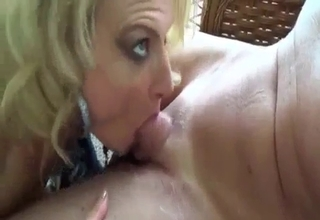 Blonde blows her brother on a balcony