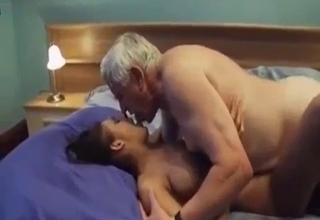 Tanned hottie takes dad's cock