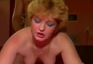 Short-haired bitch rides her sons' cock