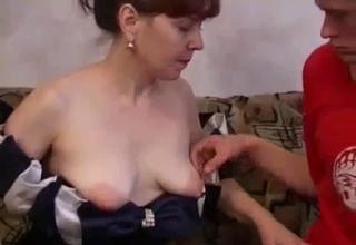 Dress-wearing slut deepthroats it