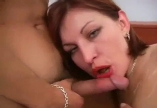 Mommy passionately blows her boy