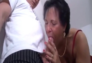 Leathery and wrinkly mommy blows her boy