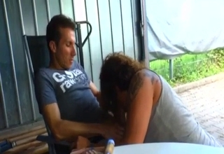 Mother blows her big boy in a garage