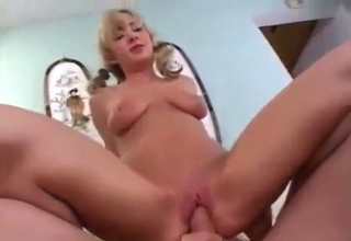 Skirt-wearing chick rides that dick