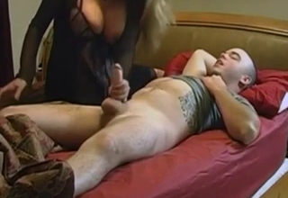 Blond-haired beauty handles that cock