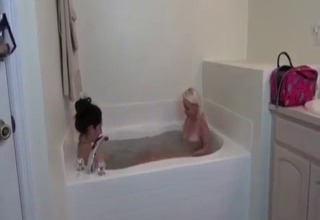 Two sisters taking a bath together